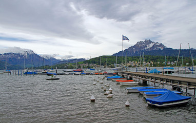boats parking with mountain background on lake Lucerne
