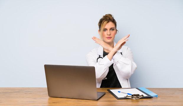 Blonde doctor woman making NO gesture