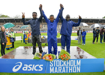 Second placed Tafese Delegen of Ethiopia, Winner Nigussie Sahlesilassie of Ethiopia and third placed Gilbert Kollum Yegon of Kenya at the podium after Stockholm Marathon 2019 at the Stockholm Olympic Stadium