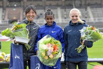 Second placed Haruka Yamaguchi of Japan, Winner Fayesa Aberash of Ethiopia and third placed Mikaela Larsson of Sweden at the podium after Stockholm Marathon 2019 at the Stockholm Olympic Stadium
