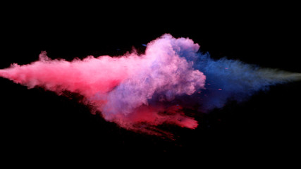 Collision of colored powder isolated on black