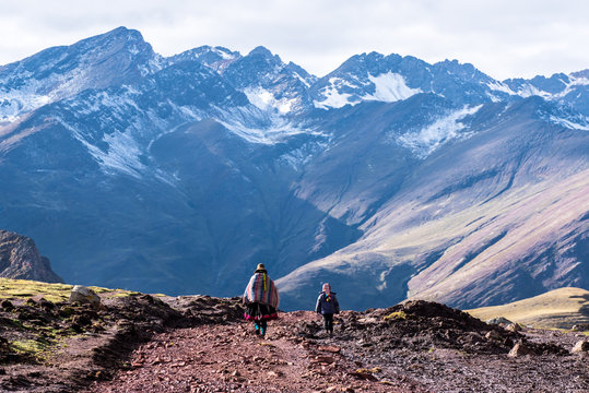 Mother and Child from Behind walking in Andes Mountains of Peru