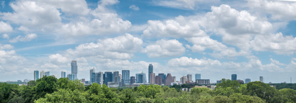 Panoramic View of Austin Texas Downtown Skyline With Bright Sun and Cloudy Skies