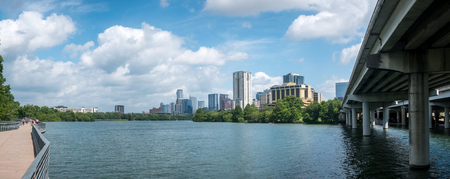 Panoramic View of Lady Bird Lake With Runners and Kayak and Austin Skyline in the background