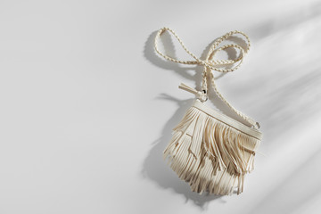 Wall Mural - Fashion white handbag with fringe. Flat lay, top view. Spring/summer fashion concept.