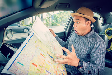 Driver reading map and get lost.Bad navigation concept.