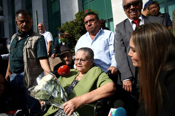 Consuelo Loera, mother of the Mexican drug lord Joaquin 'El Chapo' Guzman, receives a bouquet of flowers as she leaves the U.S. embassy after requesting a humanitarian visa so she can visit her imprisoned son, in Mexico City