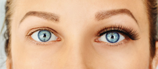 Female eyes with long false eyelashes, befor and after change. Eyelash extensions, make-up, cosmetics, beauty