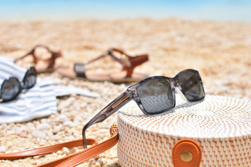 Woman beach accessories lying on a sand