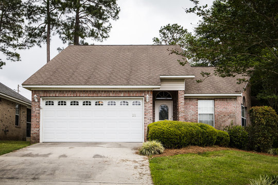 Front of Small Brick House with large yard and curb appeal