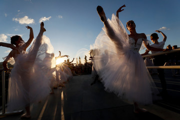 Participants attend an outdoor ballet lesson during the Global Ballet Holidays Festival in Moscow