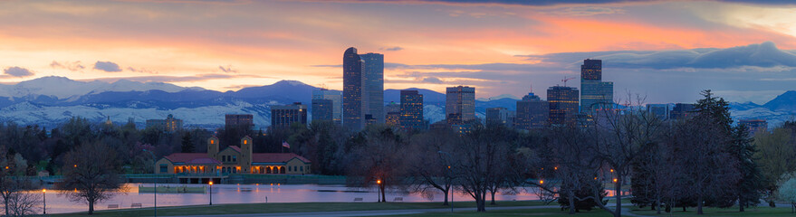 Denver skyline with colorful sunset and Mount Evans