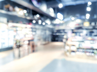 Blur background with bokeh of Supermarket store