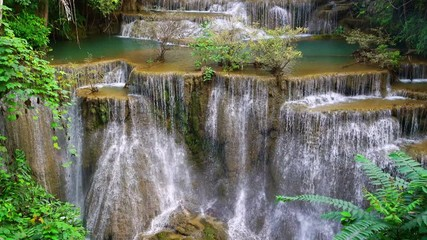 Wall Mural - Waterfall flow standing with forest enviroment high angle view in thailand called Huay or Huai mae khamin in Kanchanaburi province, Thailand., Lockdown.