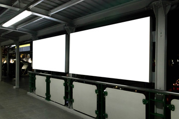 Fototapeta Two blank billboards situated at a train location. Blank horizontal big poster in public place. obraz