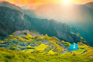 Wall Mural - Wonderful glacier lake and mountain ridge at sunset, Romania