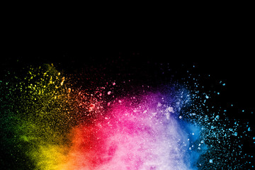 Abstract colorful powder explosion on black background.Freeze motion of dust splash.Painted Holi.