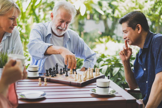 Senior old man playing chess game on chess board for strategy and planning concept
