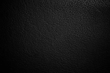 black paper texture or background with spotlight, dark tone