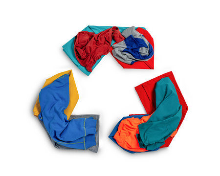 Shape of recycle symbol from fabric scraps, old clothing and textiles