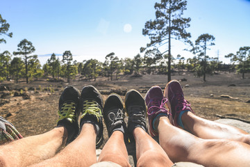 Family selfie pic in a mountain park Legs of traveller family in a trekking day together. Travel lifestyle vacation Feet with mountain boots and sport shoes. Leisure adventure and togetherness concept