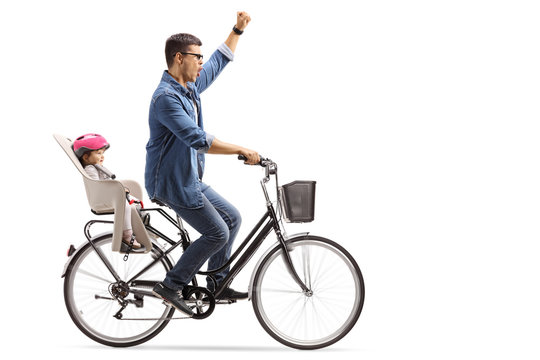 Happy father riding a baby in a bicycle child's seat