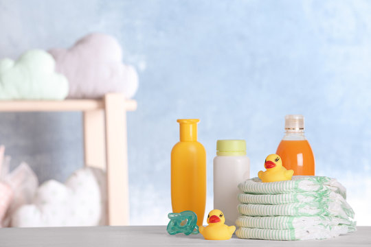 Set with baby accessories on table indoors, space for text
