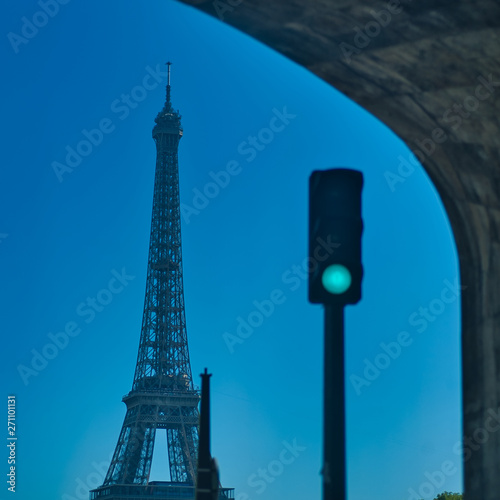 Wall mural Eiffel Tower and green traffic light below bridge, Paris, France