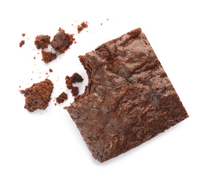 Piece of fresh brownie on white background, top view. Delicious chocolate pie