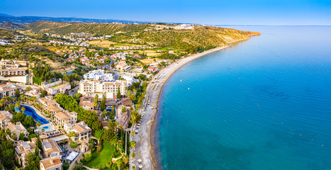 Printed roller blinds Cyprus Pissouri. Cyprus Republic. Pissouri beach in a sunny day panorama from a drone. Residential settlements on the Mediterranean sea coast. The picturesque blue bay. The Pissouri resort. Travel to Cyprus.