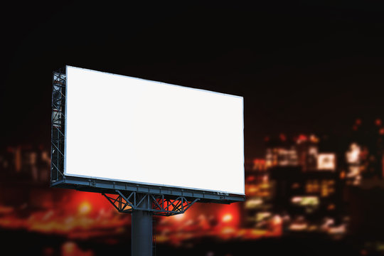 Blank billboard mockup with white screen night city background. Copy space banner for advertisement. Business Concept.
