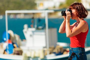Tourist take photo in greek marina