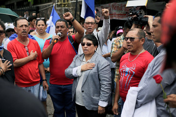 Suyapa Figueroa, President of the Medical College of Honduras, takes part in a march to protest against President Juan Orlando Hernandez government's plans to privatise healthcare and education, in Tegucigalpa