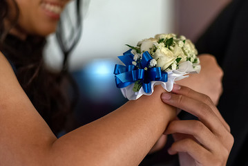 Corsage on female wrist - high school prom date