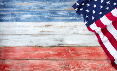 United States flag of America on rustic wooden boards painted in traditional national colors with plenty of copy space