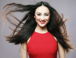 lifestyle and people concept - Young beautiful asian woman wearing red dress