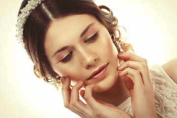 adorable young bride with gorgeous diadem in her hair