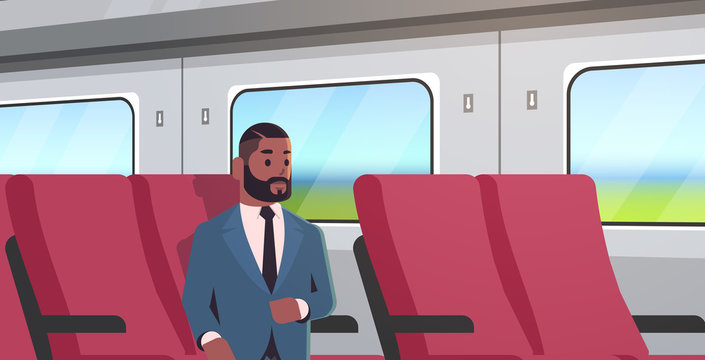 businessman traveling by train african american passenger man in suit sitting on comfortable chair during business trip travel long short distance public transport concept portrait horizontal