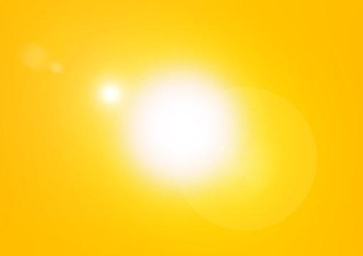 Blazing yellow sun background