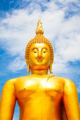 Big Golden Buddha with blue sky blue at Wat Muang, Ang Thong Province, Thailand