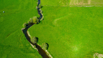 river and green meadow, aerial view