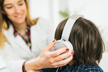 Hearing Test for Children - Audiologist Working with a Little Boy