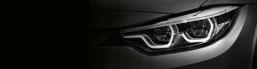 Detail on one of the LED headlights Gray modern car.copy space Wall mural