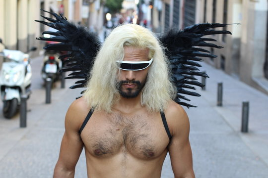 Gorgeous shirtless futuristic looking ethnic man with wings