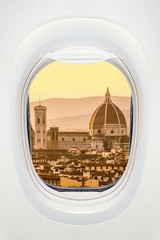 Wall Mural - Florence at sunset seen through the window of airplane, travel in Europe concept