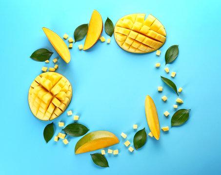 Frame made of tasty fresh mango on color background