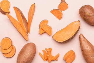 Fotobehang - Fresh sweet potatoes on light background