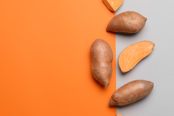 Fresh sweet potatoes on color background Wall mural