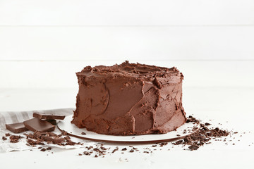 Tasty chocolate cake on white background