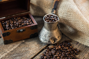 Fotobehang Koffiebonen coffee beans and turk on a wooden background